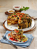 Oven-baked pasta and minced meat cake with grilled aubergines