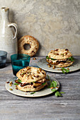 Nut and sesame seed bagels with hummus and roasted aubergines