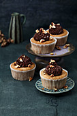 Pecan nut and banana muffins with chocolate and peanut cream