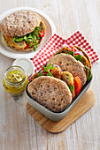 Focaccia with tuna and potato burger and hummus