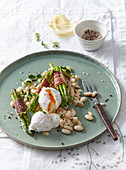 Poched egg with asparagus and bean salad