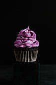 Chocolate cupcake with black currant marshmallow frosting