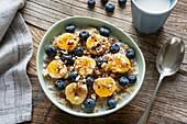 Muesli with bananas, blueberries and honey