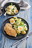 Potato salad with spring onion and chicken steak