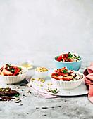 Stracciatella creme with marinated strawberries and pine nuts