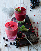 A blueberry smoothie with grapes and pomegranate seeds