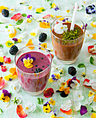 A blackberry smoothie, and a chocolate smoothie with pistachio nuts