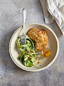 Zucchini salad with chicken in parmesan crust