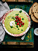Wild garlic soup with egg and cherry tomatoes