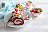 Cocoa roll with custard cream and strawberries