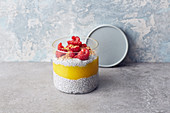 Chia pudding with coconut milk, mango and raspberries