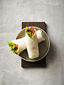Tagliata wraps with cos lettuce and goat's cream cheese