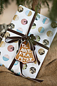 Wrapped Christmas present with gingerbread tag