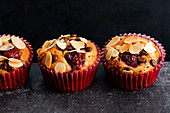 Cherry muffins with chocolate chips and flaked almonds
