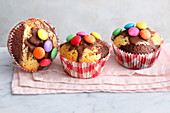 Marble cake muffins decorated with colourful chocolate beans