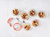 Roasted oriental nuts in flip-top jars