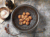 Cracked Walnuts in Silver Bowl