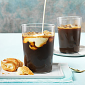 Iced Coffees With Milk Pour And A Cannoli Pastry