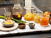 Various Jars of Chili Oil And Candied Fruit
