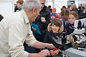 Scientist explaining diatoms at a science fair
