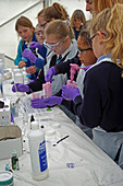 Schoolchildren making slime
