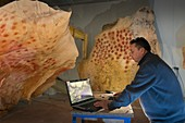 Checking replica panels of the Chauvet Cave, France