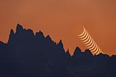 New Moon over mountain peaks