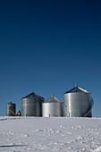 Grain storage bins in winter