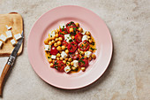 Chickpea and tomato salad with feta cheese and parsley