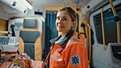 Paramedic smiles in ambulance