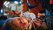 Man with respiratory mask in ambulance