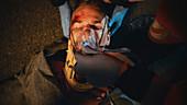 Paramedics treating hit and run victim