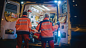 Team of paramedics treating injured patient