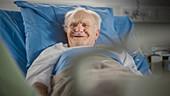 Elderly man resting in hospital bed