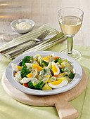 Refined egg ragout with vegetables and herb sauce