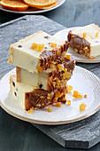 Cheesecake with caramel glaze and orange zest
