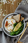 Poached Eggs on Labneh with Arugula and Avocado