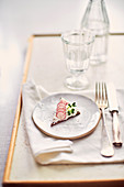 Pumpernickel canapes with cream cheese, cress and radishes