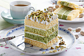 Mini cake layered with cream and pistachio sprinkles