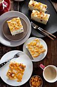 Pieces of cheesecake with raisins and orange peel
