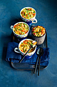'Confetti' casserole for kids with peas, carrots and sausages