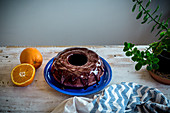 Chocolate bundt cake with coconut sugar and orange chocolate glaze