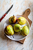 Five fresh yellow and green pears