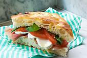 Deli sandwich with ham, tomatoes and mozzarella