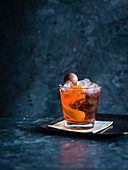 Ron de replay cocktail with Aperol, Grand Marnier and Mozart chocolate ball