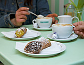 Cannoli and cappuccino for two