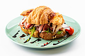 French croissant with jambon and vegetables