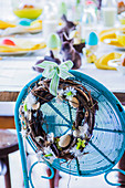 Easter wreath of branches with small eggs and feathers