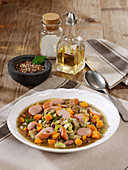 Lentil pot with sausages and bacon
