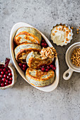 Sweet poppy seed cottage cheese fritters with rock cranberry jam, sour cream and caramelized almonds
